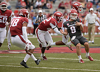 NWA Democrat-Gazette/ANDY SHUPE<br /> Arkansas quarterback John Stephen Jones (9) is touched down by linebacker Deon Edwards (22) Saturday, April 6, 2019, during the Razorbacks' spring game in Razorback Stadium in Fayetteville. Visit nwadg.com/photos to see more photographs from the game.