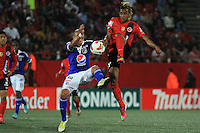 TIJUANA -MÉXICO, 10-04-2013. Fidel Martinez (D) del Tijuana y Juan Ortiz (I) de Millonarios disputan el balón durante el juego de la fase de grupos de la Copa Libertadores 2013 en el Estadio Caliente en Tijuana, Mexico./  Fidel Martinez  (r) of Tijuana and Juan Ortiz (l) of Millonarios fights for tha ball during match of the groups stage of Libertadores Cup 2013 at Caliente stadium in Tijuana, Mexico.  Photo: Fausto Vargas /JAM MEDIA/VizzorImage