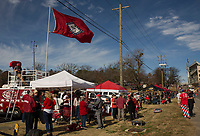 NWA Democrat-Gazette/CHARLIE KAIJO Tailgaters hang out ahead of a football game on Friday, November 24, 2017 at Razorback Stadium in Fayetteville.