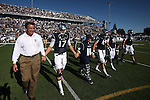 Mason Kamerer joins Gov. Brian Sandoval, left and Nevada's team captains on the field before an NCAA college football game against UNLV, in Reno, Nev., on Saturday, Oct. 26, 2013.<br />