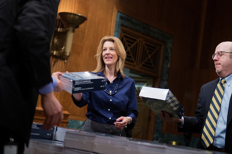 UNITED STATES - FEBRUARY 02: Stephanie Kelton, chief economist for the Senate Budget Committee's minority staff, picks up copies of President Obama's budget for fiscal year 2016, in Dirksen Building, February 2, 2015. (Photo By Tom Williams/CQ Roll Call)