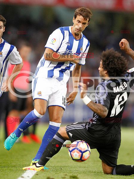 Real Sociedad's Xabi Prieto (l) and Real Madrid's Marcelo Vieira during La Liga match. August 21,2016. (ALTERPHOTOS/Acero) /NORTEPHOTO