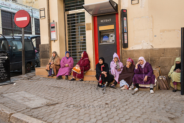 After a long day of making a living, these woment are focused on being home. (Fez, Morocco)
