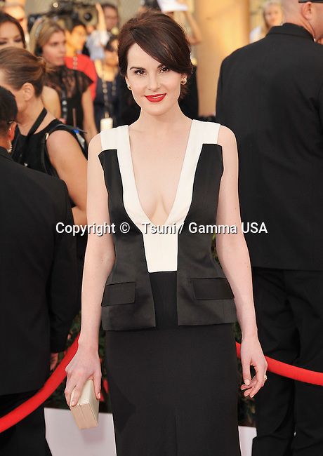 Michelle Dockery  arriving at the 20th SAG Awards 2014 at the Shrine Auditorium in Los Angeles.