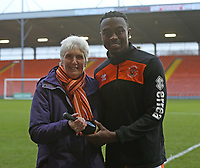 Blackpool's Joe Dodoo iis presented with a bottle of champagne for being Blackpool FC Player Of The Month for November 2018<br /> <br /> Photographer Stephen White/CameraSport<br /> <br /> The EFL Sky Bet League One - Blackpool v Charlton Athletic - Saturday 8th December 2018 - Bloomfield Road - Blackpool<br /> <br /> World Copyright &copy; 2018 CameraSport. All rights reserved. 43 Linden Ave. Countesthorpe. Leicester. England. LE8 5PG - Tel: +44 (0) 116 277 4147 - admin@camerasport.com - www.camerasport.com