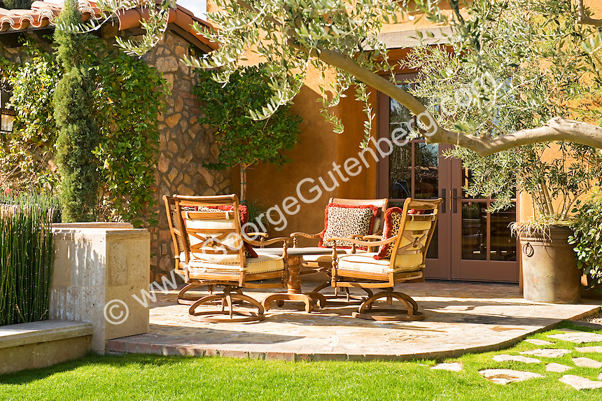 View of patio seating area of Tuscan style home