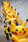 "Visitors take pictures with the Pikachus at the ""1000 Pikachu Outbreak! at Yokohama Minatomirai"" on August 09, 2014. 1000 Pikachu performed at different areas of Minatomirai in Yokohama during the summer vacation event from August 9 to 17.  (Photo by Rodrigo Reyes Marin/AFLO)"