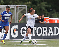Portland Thorns FC midfielder Meleana Shim (6) brings the ball forward. . In a National Women's Soccer League (NWSL) match, Portland Thorns FC (white/black) defeated Boston Breakers (blue), 2-1, at Dilboy Stadium on July 21, 2013.