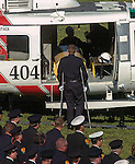 September 20, 2004 Angels Camp, California --Tuolumne Fire –- Firefighter Jon Andahl, injured in the Tuolumne Fire that killed fellow crew member Eva Marie Schicke, walks with crutches to CDF helicopter 404 at the end of Schicke's memorial service. Schicke's casket was loaded into the helicopter by her Helitack crew members for her last flight home. The memorial service was held at the Calaveras County Fairgrounds.  The Tuolumne Fire was a small very fast-moving fire that started around noon on September 12, 2004 near Lumsden Bridge at the bottom of the Tuolumne River.  The fire moved rapidly up the 80-plus-degree slope catching Cal Fire Helitack firefighters, tragically killing firefighter Eva Marie Schicke and injuring five others.