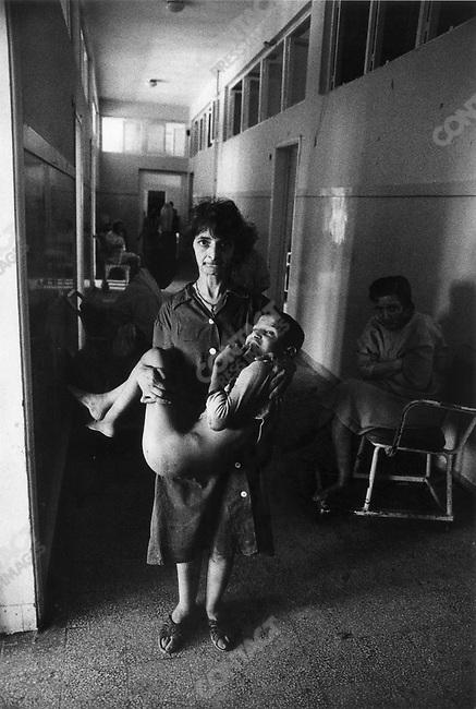 Patients in mental hospital after it was hit by shells during the siege of Beirut, Lebanon, 1982