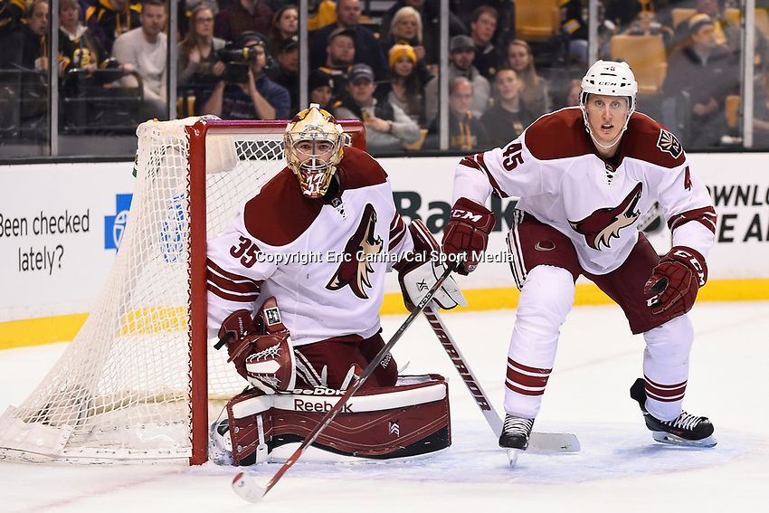 February 28, 2015 - Boston, Massachusetts, U.S. - Arizona Coyotes goalie Louis Domingue (35) and defenseman Andrew Campbell (45) in game action during the NHL match between the Arizona Coyotes and the Boston Bruins held at TD Garden in Boston Massachusetts. Eric Canha/CSM