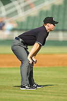 Umpire Lewis Williams handles the calls on the bases during the South Atlantic League game between the Rome Braves and the Kannapolis Intimidators at CMC-Northeast Stadium on August 25, 2013 in Kannapolis, North Carolina.  The Intimidators defeated the Braves 9-0.  (Brian Westerholt/Four Seam Images)