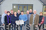 Builder Stephen Kelliher hands over the keys of the new extension to the Kilmurry NS Principal Therese Carmody and the board of management on Tuesday morning l-r: Maurice Costello, Brid Wrenn, George O'Connor, Therese Carmody, Cieran Carmody arcitect, Stephen Kelliher, Michael Williams, Monsignor Dan O'Riordan, Brian O'Connor and Elaine Moriarty