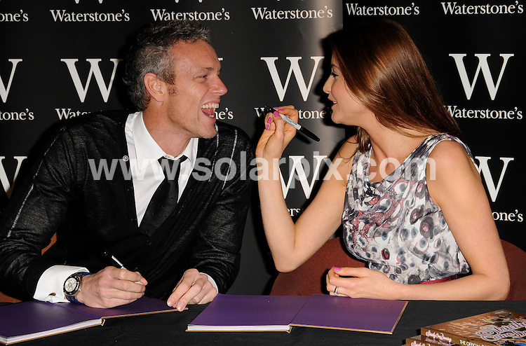 **ALL ROUND PICTURES FROM SOLARPIX.COM**.**WORLDWIDE SYNDICATION RIGHTS**.The Strictly come dancing TV crew Lisa Snowdon, Mark Foster and Heather Small promoting their new book at waterstones photocall in London today.This pic:Mark Foster and Lisa Snowdon..JOB REF:7878- MSR    DATE:13-11-08 .**MUST CREDIT SOLARPIX.COM OR DOUBLE FEE WILL BE CHARGED* *UNDER NO CIRCUMSTANCES IS THIS IMAGE TO BE REPRODUCED FOR ANY ONLINE EDITION WITHOUT PRIOR PERMISSION*