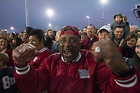 Arkansas Democrat-Gazette/BENJAMIN KRAIN --12/29/2014--<br /> Robert Boyd, from Memphis, father of Arkansas defensive lineman Cordale Boyd, cheers with Razorback fans outside RNG Stadium in Houston before Monday night's Texas Bowl.