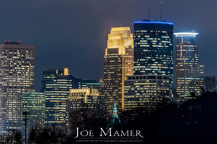 Minneapolis skyline at night from Cedar Lake Parkway.