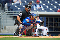Umpire John Bostwick and Iowa Cubs catcher Willson Contreras (40) await a pitch during a game against the Nashville Sounds on May 4, 2016 at First Tennessee Park in Nashville, Tennessee.  Iowa defeated Nashville 8-4.  (Mike Janes/Four Seam Images)