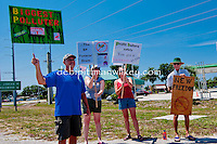 Holding signs and waving at honking supporters a small group gathered at BP service station along the Tamiami Trail in Port Charlotte, Florida, USA on Saturday, June 12, 2010.  Photo by Debi PIttman Wilkey
