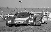 The #10 Porsche 962 of John Hotchkis Jr.,  Jim Adams and John Hotchkis races to a fifth place finish in the Rolex 24 at Daytona, Daytona International Speedway, Daytona Beach, FL, February 1, 1987.  (Photo by Brian Cleary/www.bcpix.com)