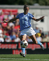 OCT 2, 2005: College Park, MD, USA:  UNC Tarheel midfielder #9 Kacey White takes a shot while playing the Maryland Terrapins at Ludwig Field.  UNC won, 4-0. Mandatory Credit: Photo By Brad Smith (c) Copyright 2005 Brad Smith