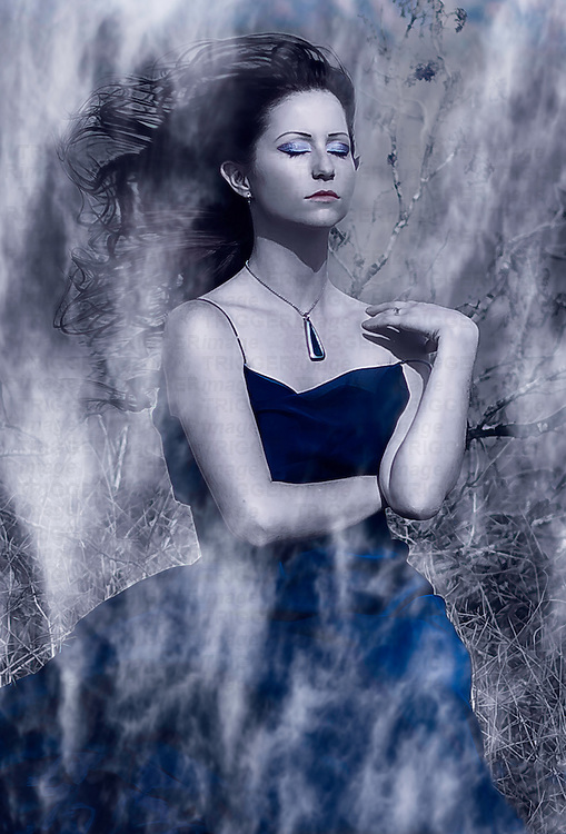 Conceptual image of a young woman wearing a long blue dress standing outdoors