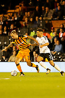 Ryan Fredericks of Fulham holds Kamil Grosicki of Hull City   during the Sky Bet Championship match between Fulham and Hull City at Craven Cottage, London, England on 13 September 2017. Photo by Carlton Myrie.