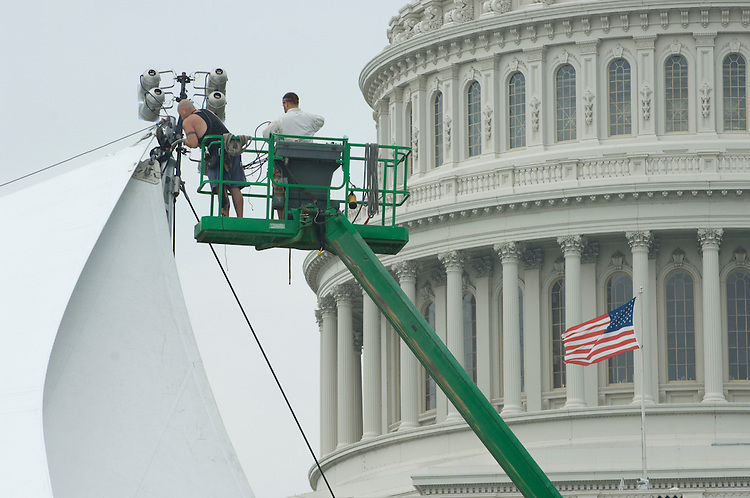 Workers clear the stage on the West Front of the U.S. Capitol after the 4th of July celebrations.