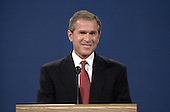 Republican Texas Governor George W. Bush smiles October 3, 2000 at the University of Massachusetts in Boston, Massachusetts during the first presidential debate with his opponent Vice President Al Gore.  <br /> Credit: Darren McCollester / Pool via CNP