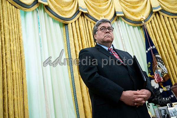 United States Attorney General William P. Barr looks on as US President Donald J. Trump makes remarks before the president signed an executive order in the Oval Office of the White House in Washington, DC that will punish Facebook, Google and Twitter for the way they police content online, Thursday, May 28, 2020. <br /> Credit: Doug Mills / Pool via CNP/AdMedia