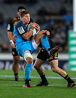 Piers Francis of the Blues takes the ball under pressure during the Super Rugby Match between the Blues and the Chiefs at Eden Park in Auckland, New Zealand on Friday, 26 May 2017. Photo: Simon Watts / www.lintottphoto.co.nz