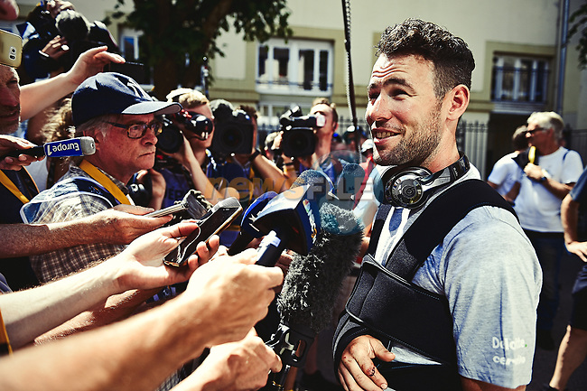 Mark Cavendish (GBR) Dimension Data out with a broken shoulder after yesterday's crash talks to the media at the team bus before the start of Stage 5 of the 104th edition of the Tour de France 2017, running 160.5km from Vittel to La Planche des Belles Filles, France. 5th July 2017.<br /> Picture: ASO/Pauline Ballet | Cyclefile<br /> <br /> <br /> All photos usage must carry mandatory copyright credit (&copy; Cyclefile | ASO/Pauline Ballet)