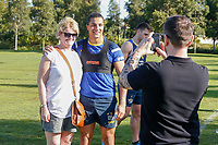 Picture by Brendon Ratnayake/SWpix.com - 14/02/2018 - Rugby League - Dacia World Club Challenge - Melbourne Storm v Leeds Rhinos - Gosch's Paddock, Melbourne, Australia - A fan has a photo taken with Ashton Golding of Leeds Rhinos