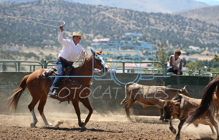 Nick Uhart competes with the Hone NIX team in the branding event at the Minden Ranch Rodeo on Sunday, July 24, 2011, in Gardnerville, Nev. .Photo by Cathleen Allison
