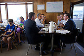 United States President Barack Obama has breakfast with small business owners at Rausch's Cafe in Guttenberg, Iowa, during a three-day bus tour in the Midwest, August 16, 2011. .Mandatory Credit: Pete Souza - White House via CNP