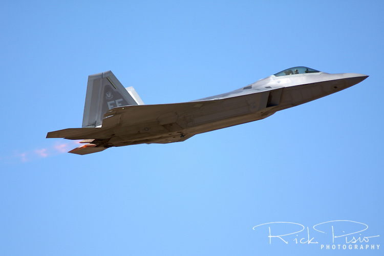 """United States Air Force pilot  Major Paul """"Max"""" Moga, flying the F-22 Raptor, makes a pass in afterburner as part of an airpower demonstration during the 2008 Reno National Championship Air Races at Stead Field in Nevada."""