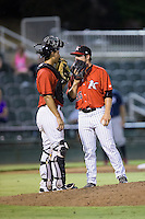 Kannapolis Intimidators catcher Seby Zavala (21) has a chat on the mound with relief pitcher Michael Horejsei (30) during the game against the Lakewood BlueClaws at Kannapolis Intimidators Stadium on August 11, 2016 in Kannapolis, North Carolina.  The Intimidators defeated the BlueClaws 3-1.  (Brian Westerholt/Four Seam Images)