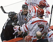 Chris Rooney (PC - 21) and Max Nicastro (BU - 7) are separated by Chris Aughe.  - The Boston University Terriers defeated the visiting Providence College Friars 6-1 on Friday, January 20, 2012, at Agganis Arena in Boston, Massachusetts.