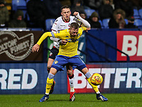 Bolton Wanderers' Craig Noone competing with Leeds United's Barry Douglas<br /> <br /> Photographer Andrew Kearns/CameraSport<br /> <br /> The EFL Sky Bet Championship - Bolton Wanderers v Leeds United - Saturday 15th December 2018 - University of Bolton Stadium - Bolton<br /> <br /> World Copyright &copy; 2018 CameraSport. All rights reserved. 43 Linden Ave. Countesthorpe. Leicester. England. LE8 5PG - Tel: +44 (0) 116 277 4147 - admin@camerasport.com - www.camerasport.com