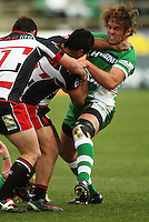 Counties winger Lelia Masaga tries to fend off Grant Polson during the Air NZ Cup rugby match between Manawatu Turbos and Counties-Manukau Steelers at FMG Stadium, Palmerston North, New Zealand on Sunday, 2 August 2009. Photo: Dave Lintott / lintottphoto.co.nz