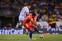 Chicago, IL - Wednesday June 22, 2016: James Rodriguez, Jean Beausejour during a Copa America Centenario semifinal match between Colombia (COL) and Chile (CHI) at Soldier Field.