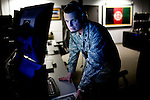 13th Intelligence Squadron commander Lt. Colonel Jason Brown works on the operations floor at Beale Air Force Base in Linda, Calif., April 30, 2010.