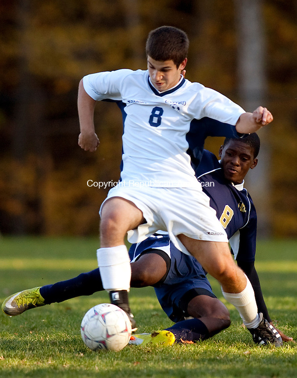 OXFORD, CT, 19 OCTOBER 2010-101910JS07-Oxford's Keith O'Hara (8), avoids a sliding tackle by Notre Dame-Fairfield's Marques Johnson (8) during their game Tuesday at Oxford High School. <br />  Jim Shannon Republican-American