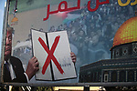 "A picture taken on June 17, 2019, shows a poster in Gaza City denouncing the US Middle East peace plan dubbed the ""deal of the century"".  Arabic writing on poster reads ""The deal of the century will not pass"".  Photo by Mahmoud Ajjour"