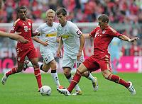 FUSSBALL   1. BUNDESLIGA  SAISON 2011/2012   1. Spieltag   07.08.2011 FC Bayern Muenchen - Borussia Moenchengladbach         Bastian Schweinsteiger (re, FC Bayern Muenchen) gegen Havard Nordtveit (Mitte, Borussia Moenchengladbach)