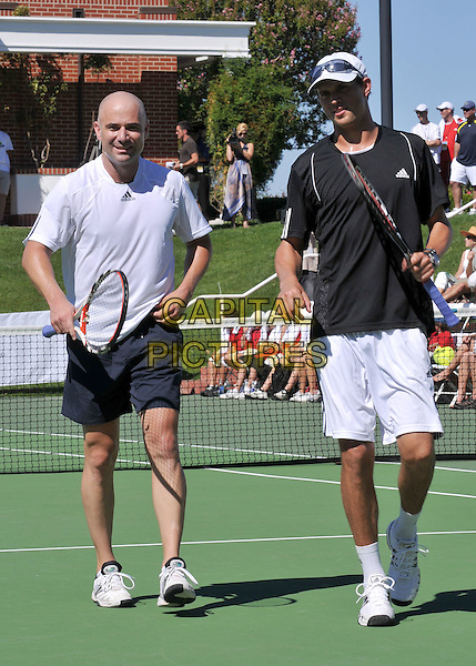 ANDRE AGASSI & MIKE BRYAN .The Bryan Brothers? All-Star Tennis Smash 2008 at the Sherwood Country Club, Thousand Oaks, California, USA, .27th September 2008.sport game sports playing full length white adidas top racquet  shorts court walking .CAP/ADM/BP.©Byron Purvis/Admedia/Capital PIctures