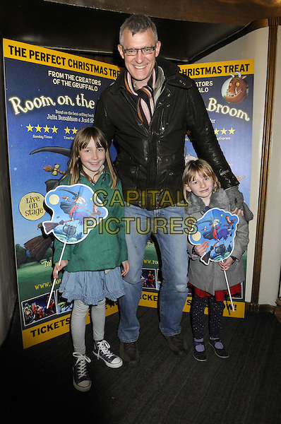 Jeremy Vine & Guests  .Attending a special VIP performance of 'Room On The Broom' at the Lyric Theatre, London, England, UK, .December 1st 2012..full length glasses jeans scarf girls daughters?.CAP/BK/PP.©Bob Kent/PP/Capital Pictures