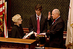 Illinois Lt. Gov. Pat Quinn, right, takes the oath of office to become the new Governor of Illinois as his son Pat Quinn IV, left, holds the bible at the State capitol in Springfield, Ill., on January 29, 2009. Quinn replaces former Gov. Rod Blagojevich after his impeachment..Kristen Schmid Schurter
