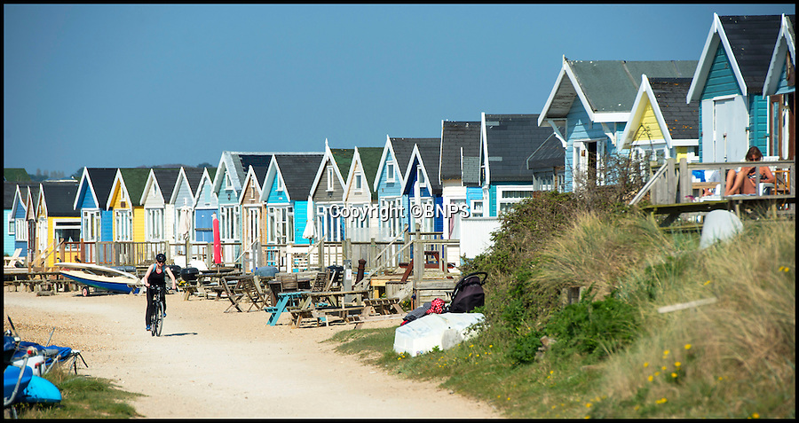 BNPS.co.uk (01202 558833)<br /> Pic: David Fitzgerald/BNPS<br /> <br /> A beach hut on a remote sandbank has been put up for sale for £230,000 - the same price as a family home in many parts of Britain.<br /> <br /> This timber hut is one of the most expensive on the desirable Mudeford Spit near Christchurch, Dorset, to come on the market.<br /> <br /> It commands spectacular views across the Solent - although the vista is presently blighted by a rubbish skip dumped on the spit for beach hut owners to use over-winter when they usually do their repairs.