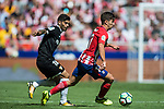 Luciano Vietto (r) of Atletico de Madrid competes for the ball with Ever Maximiliano Banega of Sevilla FC during the La Liga 2017-18 match between Atletico de Madrid and Sevilla FC at the Wanda Metropolitano on 23 September 2017 in Madrid, Spain. Photo by Diego Gonzalez / Power Sport Images