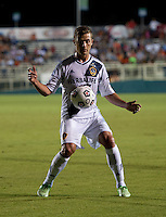 Robbie Rogers (14) of the LA Galaxy controls the ball during a third round match in the US Open Cup at WakeMed Soccer Park in Cary, NC.  The Carolina Railhawks defeated the LA Galaxy, 2-0.